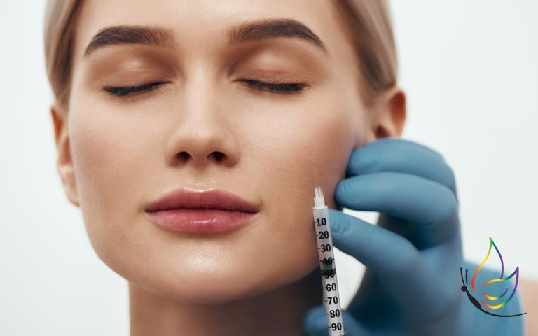 beautiful woman receiving filler injection